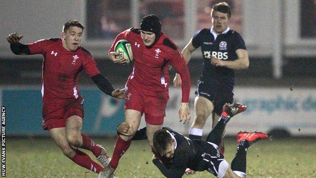 Wales' Dafydd Howells is tackled by Rory Hutchinson