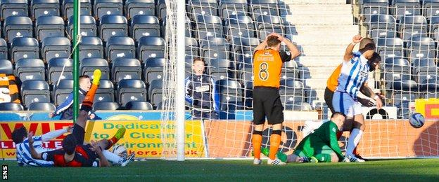 Chris Johnston squeezes in Kilmarnock second goal after a mistake from Radoslaw Cierzniak.