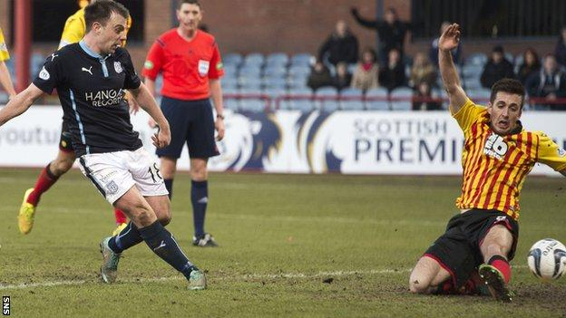 Paul McGowan (left) scored a late winner to win the game for Dundee.
