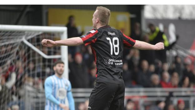 Jordan Owens got his name on the scoresheet as Premiership leaders Crusaders saw off Warrenpoint Town 4-1 at Seaview