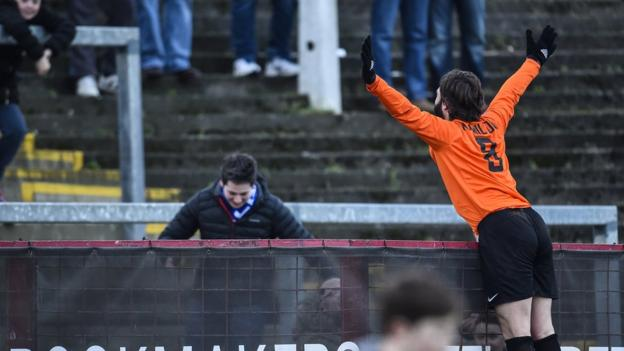 Gary Hamilton runs to celebrate with Glenavon supporters after scoring an injury-time winner to beat Glentoran 2-1 at the Oval