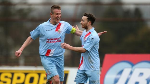 Ballymena skipper Allan Jenkins congratulates fellow goalscorer Eamon McAllister during their side's 3-0 win over Institute
