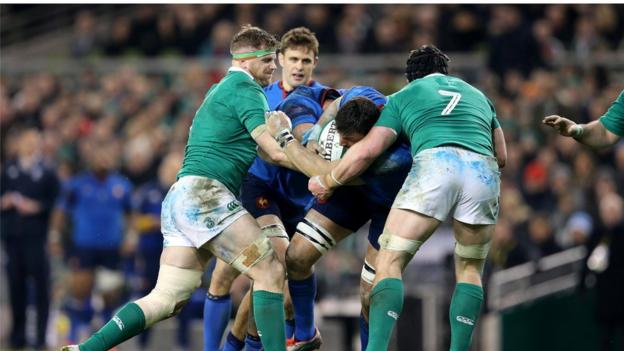 Ireland back-row forwards Jamie Heaslip and Sean O'Brien combine to tackle French opponent Bernard Le Roux