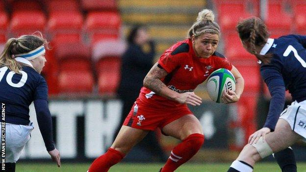Adi Taviner of Wales on the attack against Scotland women