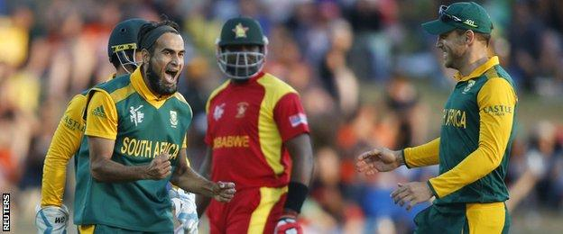 South Africa celebrate a wicket by Imran Tahir (left)