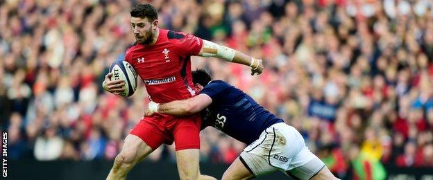 Scotland's Alex Dunbar tries to halt the progress of Alex Cuthbert