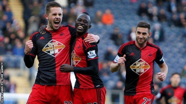 Gylfi Sigurdsson celebrates a goal for Swansea