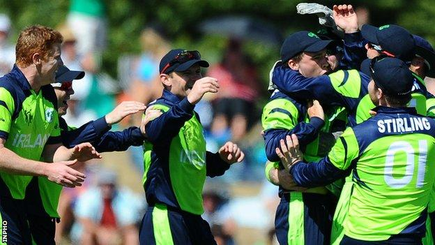 Ireland players celebrate taking the wicket of West Indies player Chris Gayle