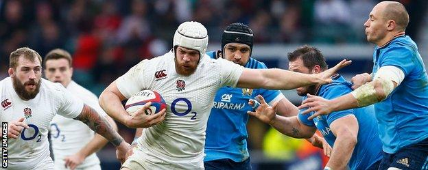 England's Dave Attwood hands off Sergio Parisse of Italy during the Six Nations match at Twickenham Stadium