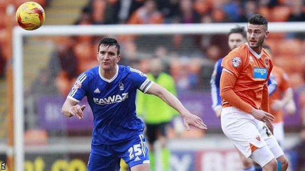 Jack Hobbs (left) in action for Forest against Blackpool