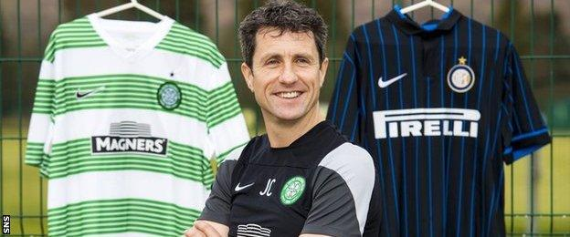 John Collins poses with Celtic and Inter Milan jerseys