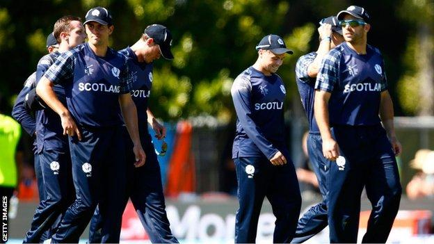 The Scotland cricket squad trudge off at the end of the defeat by New Zealand
