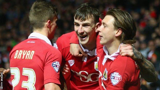 Aden Flint celebrates scoring for Bristol City