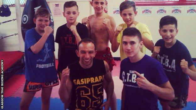 John Paul Gallacher with members of the Glasgow Thai Boxing club