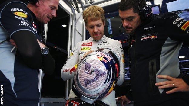 F1 world champion Sebastian Vettel with a specially-designed helmet at the 2013 British Grand Prix