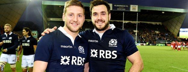 Finn Russell (left) and Alex Dunbar are also team-mates at Glasgow Warriors