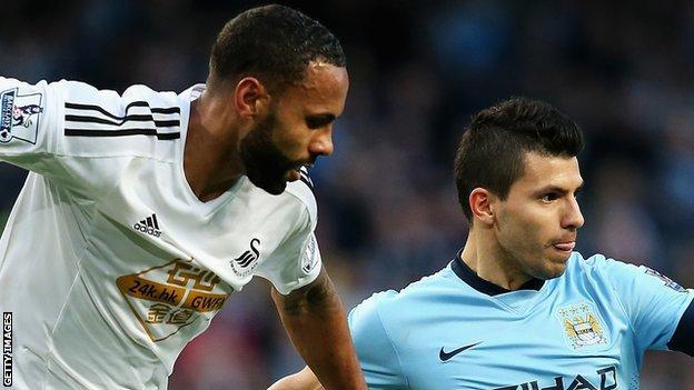 Swansea City's Kyle Bartley (left) with Manchester City's Sergio Aguero
