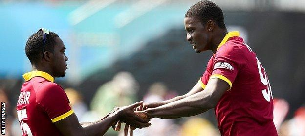 Jerome Taylor (L) and Jason Holder (R) of West Indies celebrate