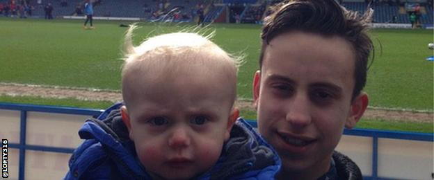 A child with his father at Ewood Park