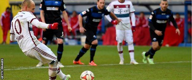 Arjen Robben scores a penalty