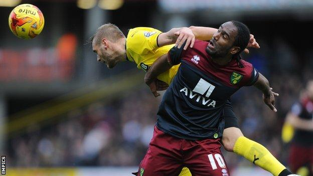 Joel Ekstrand and Cameron Jerome (front)
