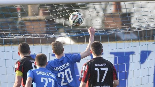 Glenavon defender Rhys Marshall hits the back of the Crusaders net to make it 1-1 at Mourneview Park