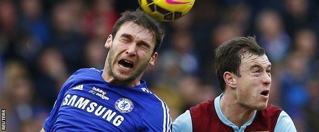 Chelsea defender Branislav Ivanovic (left) was unhappy with Ashley Barnes' challenge