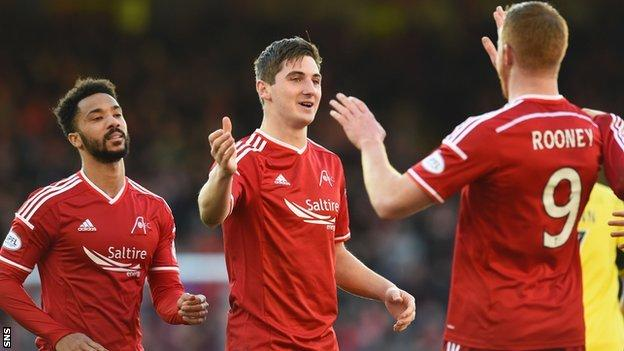Kenny McLean (centre) set-up Adam Rooney's second goal
