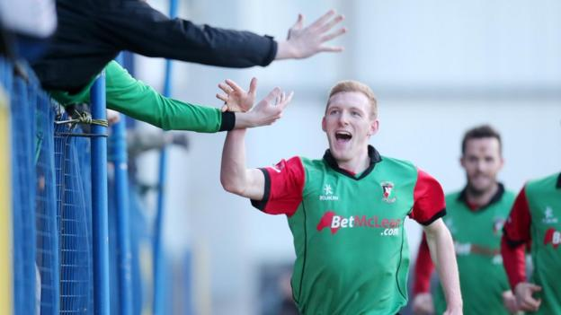 Steven Gordon celebrates with Glentoran fans after putting the east Belfast side ahead against Coleraine at the Showgrounds