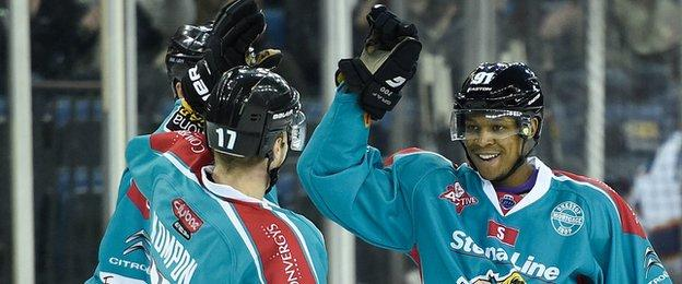 Nathan Robinson (right) celebrates his first goal while making his home debut