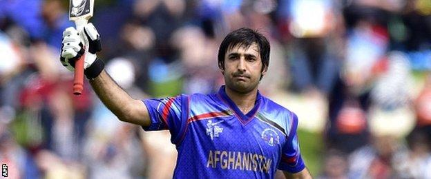 Afghanistan batsman Asghar Stanikzai celebrates 50 runs