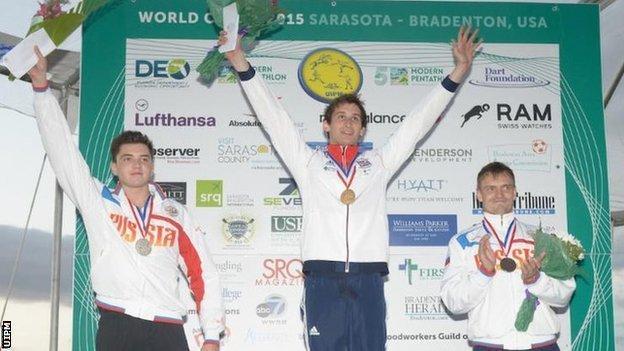 Britain's Jamie Cooke (centre) after winning gold at the Sarasota Modern Pentathlon World Cup