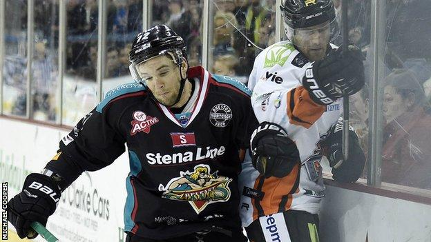 Giants forward Darryl Lloyd puts in a strong challenge on Sheffield's Tomas Petruska