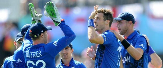 Steven Finn (second from left) celebrates taking a wicket with team-mates
