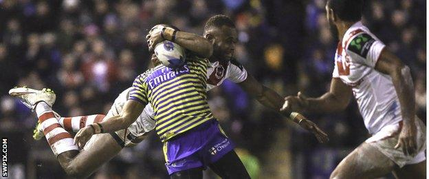 Warrington's Kevin Penny is tackled by St George's Eto Nabuli