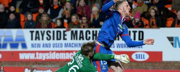 Marley Watkins is brought down by Dundee United goalkeeper Michal Szromnik early in the match