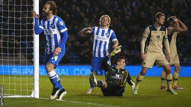 Brighton's Inigo Calderon celebrates against Leeds