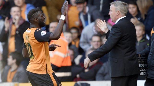 Bakary Sako celebrates a goal with Wolves boss Kenny Jackett