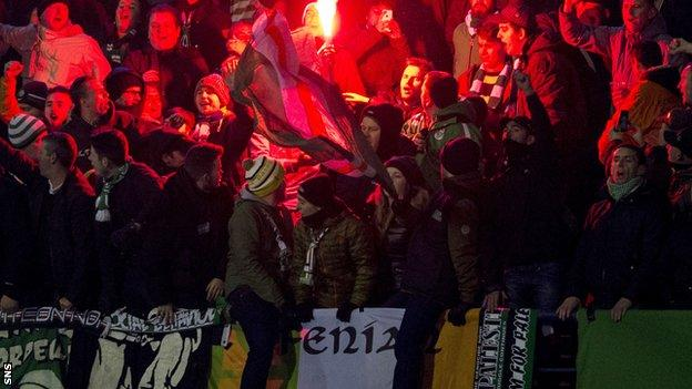 Flares are set off in the Celtic section in Zagreb