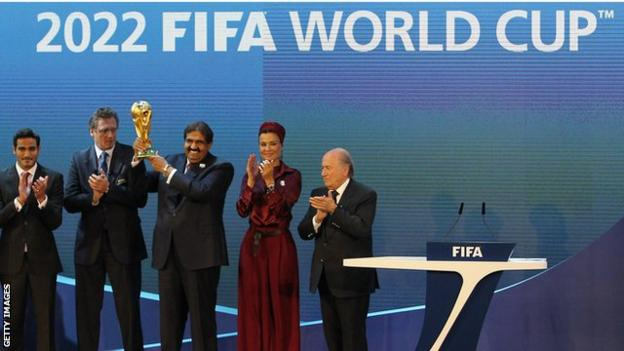 FIFA president Sepp Blatter awards Qatari officials the World Cup for 2022