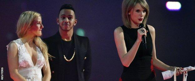 Ellie Goulding, Lewis Hamilton and Taylor Swift at the Brit Awards
