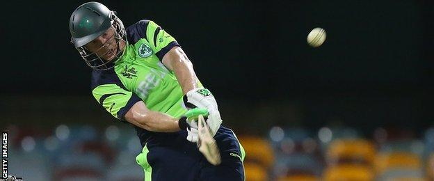Kevin O'Brien launches into a big shot on his way to a blistering half century at the Gabba