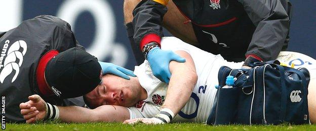 England full-back Mike Brown receives treatment by medics after being knocked out against Italy
