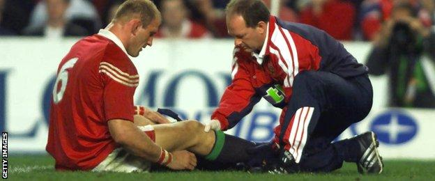Lawrence Dallaglio is attended to by the James Robson on the 2001 Lions tour