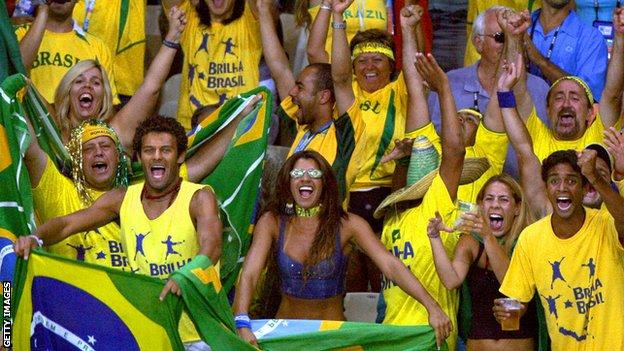 Brazil fans cheer on their team