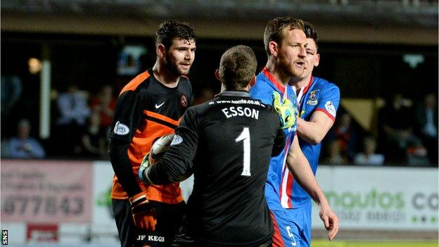 Goalkeeper Ryan Esson tries to keep Nadir Ciftci and Inverness defender Gary Warren
