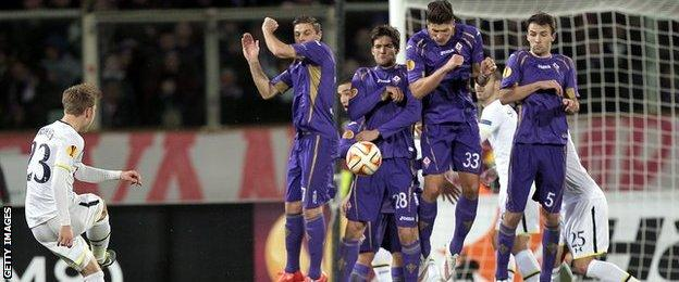 Fiorentina's wall blocks a Christian Eriksen free-kick
