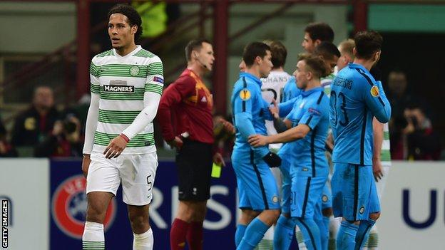 Virgil van Dijk walks off after being red carded at the San Siro