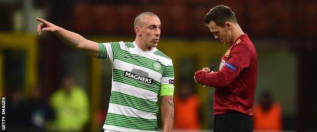 Celtic captain Scott Brown and Slovakian referee Ivan Kruzliak
