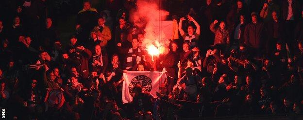 Celtic fans set off a firework in the San Siro